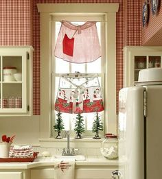 Aprons as kitchen curtains!   Too cute