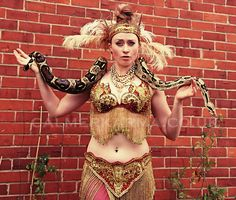 Snake Dancers to hire - this amazing snake charmer will perform 3 mins choreographed staged dance with the snake draped around her followed by walkabout so the guests can have their photo taken with the snake and touch the snake.  Perfect entertainment for Bollywood parties, Arabian themed events etc Circus Performers, Bollywood Party, Walkabout, Magic Carpet, Arabian Nights, Belly Dancers, The Conjuring, Corporate Events, Great Photos