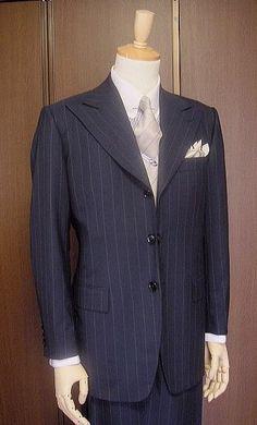 Three button peak lapel suit