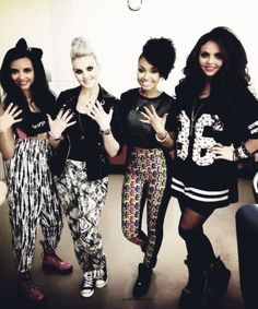 Little Mix showing off their nail collection!  I love this girl group so much! I mean I love how they have their own style and they keep COVERED UP! Most girl groups out there don't and I love them for that... and they are the most sweetest down to earth girls! <3 I love them! <3 #littlemix