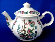 This is a vintage Sadler, England teapot in the Indian Tree or Indian Peony pattern from the 1960s. The 6 to 8 cup ironstone tea pot measures 6.5 inches high by