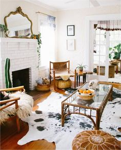 Cowhide Rug In Living Room. Cowhide Rug In Living Room. Living Room with Navy Chairs & Faux Cowhide Rug Rugs In Living Room, Home And Living, Home, Cow Hide Rug, Cheap Home Decor, Interior, Cowhide Rug Living Room, Boho Living Room, Home Decor