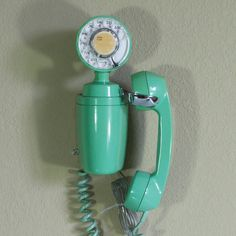 """Designed to fit into small, modern spaces, this Automatic Electric Space Saver is so small, a ringer doesn't fit. Called the """"Jetson"""" phone by some collectors. Dial unit and receiver hook are adjustable by loosening a screw inside the case. 5.5' clear wall cord. This vintage item has been refurbished and enhanced for everyday use. The phone is in working condition. Does not ring. Add-on units containing a ringer were made for this phone, Automatic Electric Model 33."""