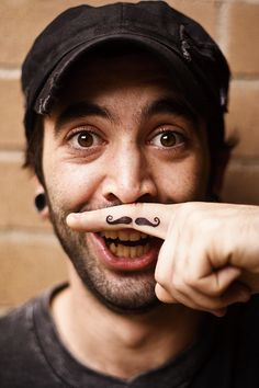 Mustache finger tattoo. Hehe! I know somewith this; too funny