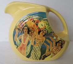 Here is a fantastic and rare disc pitcher from Homer Laughlin China. It was done by Lynn Krantz for the Dishbooks Line. The artwork motiff was from Eugene Savage's work for Matson Lines. It has little wear.   eBay!