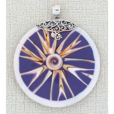 http://purpleleopardboutique.com/1168-2426-thickbox/large-round-decorateive-shell-sterling-silver-pendant.jpg Purple round large shell sterling silver pendant.
