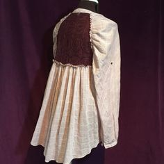 Free People button front lace back high low blouse Super cute and fashionable! Free People pins stripe blouse. White with burgundy pinstripes and lace inset in back. High low, back measured 34 in from collar. Great condition! Free People Tops Blouses