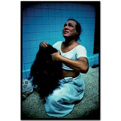 Ibrahim sometimes dresses as a man and sometimes as a woman. Falkland Road, Bombay, India. 1978  By Mary Ellen Mark