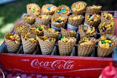 Ice cream cones filled with party snack mix. The kids would love it!