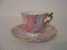 VINTAGE DEMITASSE CUP AND SAUCER PINK WHITE AND GOLD SWIRL MADE IN JAPAN