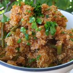 Spanish-Style Quinoa Recipe with vegetable oil, quinoa, onion, garlic, green bell pepper, tomato sauce, water, chili powder, garlic powder, ground cumin