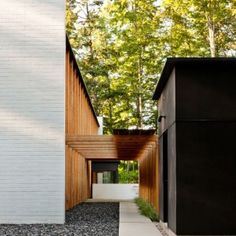 modern-brick-and-wood-pergola-and-black-exterior-for-minimalist-house-exterior