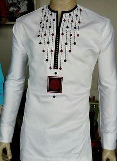 Sexy African wear , comes in off white color with a well detailed embroidery on the chest, crafted to suit all occasion. The set includes the shirt and pant. This is a beautiful hand-made outfit can be worn on all occasions Other colors are available. African Shirts For Men, African Dresses Men, African Attire For Men, African Clothing For Men, African Wear, African Style, African Women, Nigerian Men Fashion, African Print Fashion