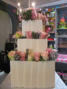 3-tier Wicked Chocolate wedding cake decorated with white chocolate tiles, dusky pink roses & fynbos by Charly's Bakery