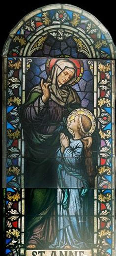 Stained Glass Window DESCRIPTION: This stained glass window depicts Saint Anne with Child Mary.