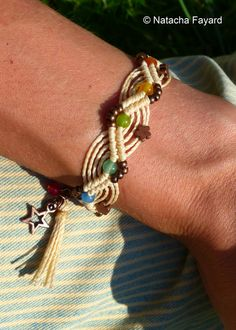 Friendship bracelet macrame. This is nice with larger beads than usual and thicker cords.