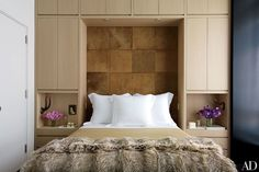 In the bedroom of Kylie Case and Gilles Mendel's Manhattan apartment, designed by David Mann of MR Architecture + Decor, the headboard is made of panels of camel-color cowhide; the linens are by Frette, and the badger-fur throw is by J. Architectural Digest, Fashion Kids, Boudoir, Next Bedroom, New York Apartments, Home Decoracion, Manhattan Apartment, Pink Bedrooms, Master Bedrooms