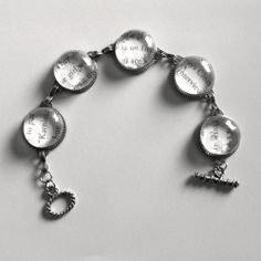 Use quotes from your favorite book and glass gems to make a personal piece of jewelry.