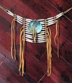 Breastplate buffalo bone choker with brass beads, abalone disc and soft buckskin ties.