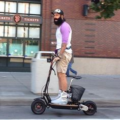 Brian Wilson on a scooter wearing moon boots.definitely one of the Things  That Make Life Worth Living in the Bay Area Photo  Brian Wilson Channels  Marty ... 8814355ad