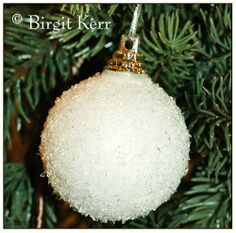snowball ornament-Shana made these today with the students. Sooo pretty! Paint the glass ball with glue, sprinkle with epsom salts (can color them with food coloring) then dry.