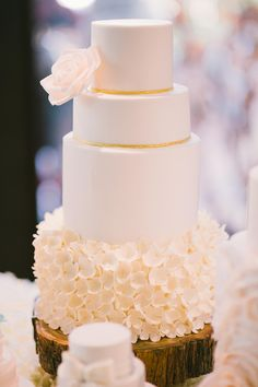 White and gold tiered wedding cake with sugar flowers // Top 10 Wedding Cake Creators in Malaysia - Part 2