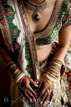 Opulent Bridal lehenga. White, green and red lehenga. #Indianbride