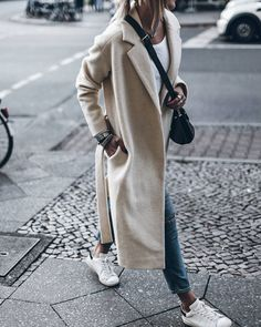 Casual but chic in denim, sneakers and offwhite long coat