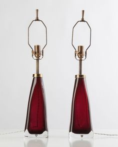 Glass, brass, sass: original 1960s red Orrefors lamps restored by Remains Lighting.