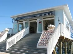 Murdoch's of Galveston, shells, souvenirs, frozen drinks on the veranda in adirondack chairs...heaven!