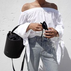 We are love with @ch.phr8ph wearing our bucket bag in blackGet on via the link in our profile. #cameliaroma