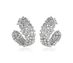 Curved clusters of diamonds adorn these lavish white gold earrings that are sure to add maximum sparkle to any look. White Gold Diamonds, Colored Diamonds, Round Diamonds, 14k White Gold Earrings, Diamond Hoop Earrings, Top Engagement Rings, Diamond Shop, Best Settings, Wedding Ring Designs