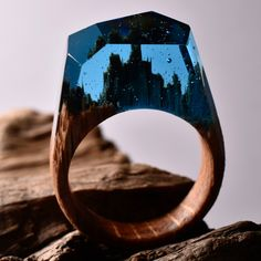 All our rings are handmade and unique. We use fresh wood, jewelry resin and beeswax.The rings are designed and made by Secret Wood exclusively.What you see is the actual ring sent to the customer, we never edit any pictures. When you order this ring, it will be similar in shape and colour, but not exactly the same - it will be one of a kind.Please note -it takes 5-6 weeks to make your ring, so please plan accordingly.We'll send you a picture of your ring before we sh...