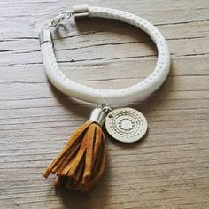 Check out this item in my Etsy shop https://www.etsy.com/uk/listing/244186662/leather-boho-bracelet-with-charm-tassle