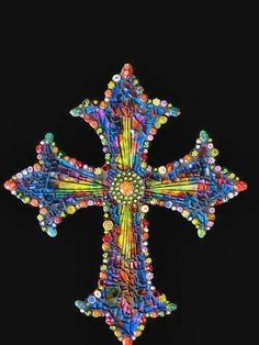Stunning and unique mosaic cross made with millefiori glass lampwork beads. First the cross is handpainted, sealed, then lined with the beads then mosaic-ed with clear tempered glass. Mosaic Crafts, Mosaic Projects, Mosaic Art, Mosaic Glass, Mosaic Tiles, Stained Glass, Kitchen Mosaic, Mosaic Crosses, Wall Crosses