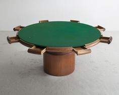 For Sale on - 'Milhazes Game Table.' Solid wood cylindrical base with green felt surface and eight drawers around edge. Designed by Sergio Rodrigues, Brazil, Design Furniture, Table Furniture, Round Poker Table, Console Table, Dining Table, Kitchen Games, Table Design, Health Insurance Companies, Open Concept Kitchen