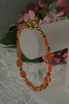 Tangerine Cat's Eye and Gold Bracelet by TrinketsbyTeri on Etsy, $7.00
