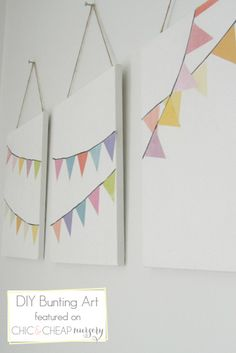Simple nursery decorations are always the best.  Perfect for the hot air balloon nursery. Could do with cards from the shower hung on actual wire so you can still read the back or insides of them!
