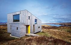 Isle of Skye Eco Home - Scotland - Super energy efficient wide open tiny home has a cement fibre corrugated roof and is heated only by passive solar gain and a multi fuel stove. And the residents save thousands of gallons of water with their composting toilet.