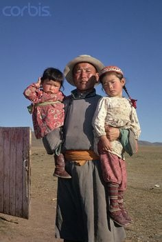 Mongolian Man and Young Daughters