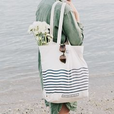Blue striped day tote, perfect for the beach, market-style shopping, + general everyday wear.