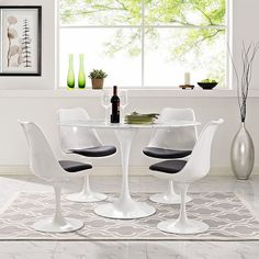 "Modway Lippa Dining Table White base with artificial marble oval top Overall: 28.5"" H x 48"" L x 27.5"" W  $579"