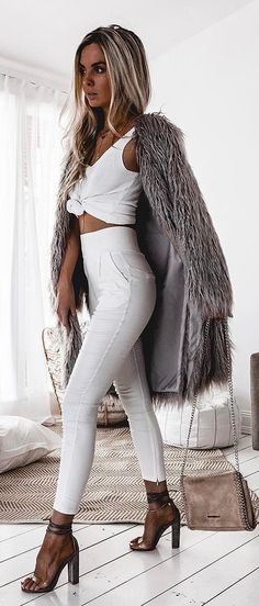 #spring #outfits  Black Faux Fur Coat + White Crop Top + White Skinny Jeans + Nude Sandals