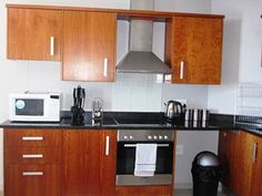 Nkosi Sikelela I'Africa Apartment 1003 - Nkosi Sikelela I'Africa Apartment 1003 is a stylish two-bedroom self-catering apartment ideally situated in a secure building in Bloubergrant with magnificent views across Table Bay, available on a whim. ... #weekendgetaways #bloubergstrand #southafrica