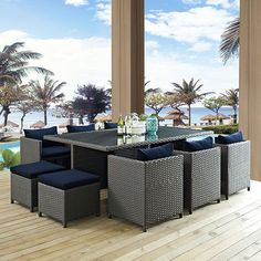 Sojourn 11 Piece Outdoor Patio Sunbrella(R) Dining Set, Canvas Navy - Outfit your patio with an imaginative outdoor sectional series of exceptional quality. The Sojourn series offers a robust seating experience that easily rearranges according to usage. Outfitted with industry-leading Sunbrella(R) fabric cushions, synthetic rattan weave, UV protection, powder-coated aluminum frame, immensely enjoy your outdoor time with a series that enhances patio, backyard or poolside areas. This…