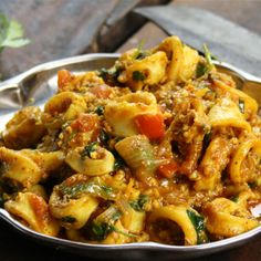 Try this Squid Curry recipe by Chef Rick Stein. This recipe is from the show Rick Stein's India.