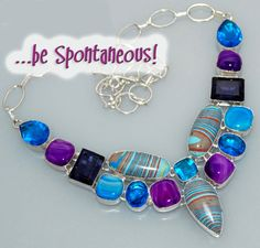 This gorgeous necklace features lovely rainbow chalcedony, alluring amethyst and blue topaz gemstones set in sterling silver. All the colors come together beautifully!
