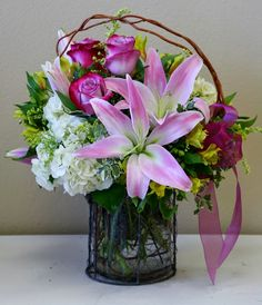 Pretty pink and white flowers in a chicken wire vase by your local Riverside florist - Willow Branch Florist of Riverside