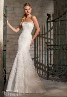 Wedding Gowns by Morilee featuring Calais Lace Appliques on Net Edged with Crystal Beading Available in White/Silver, Ivory/Silver, Champagne/Silver