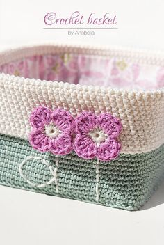 Square based crochet basket with tiny spring flowers